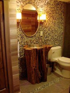 Utilizar un tronco de árbol para colocar el lavabo