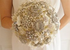 pearl and silver brooch bouquet...love that instead of flowers..def not a flower girl...don't like the smell!