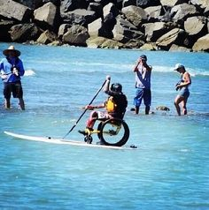 Surfing no matter what if they cannot do it do we really have an excuse. Amazing wheelchair paddle boarding.