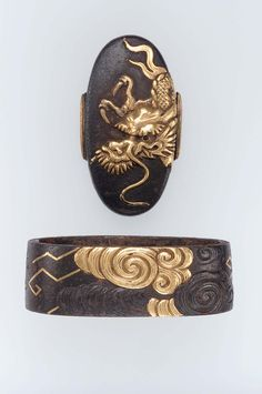 Fuchi-kashira with designs of dragon and clouds. Edo period early to mid-19th century - Yanagawa Naomasa (Japan, 1692–1757)  http://www.mfa.org/collections/object/fuchi-kashira-with-designs-of-dragon-and-clouds-9696