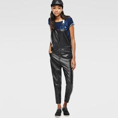 Soft leather overall with contrast back panels and suspender-style straps. Shank buttons close above the hips.