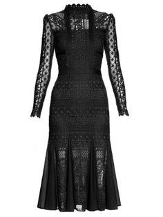 Folkloric pattern and texture inspires Temperley London's darkly romantic Pre-AW16 collection. This black Desdemona dress is crafted from richly textured lace, has a streamlined silhouette that's accentuated by cotton-gauze panels, and is lent movement by breezy godets. Offset the deep hue with jewel-toned accessories.
