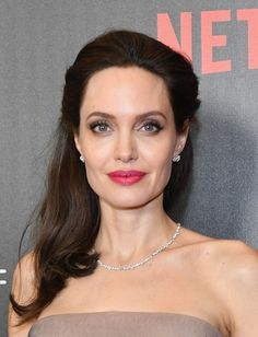 Angelina Jolie Pink Lipstick - Angelina Jolie looked radiant with her bright pink lipstick and luminous complexion.