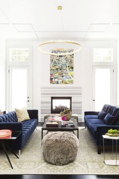 San Francisco Living Room designed by Ann Lowengart, with a pair of blue tufted sofas, via @sarahsarna.
