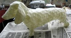 Layering method for Paper Mache - It's in Dutch but you can translate it easily enough on the page. dieren van papier maché