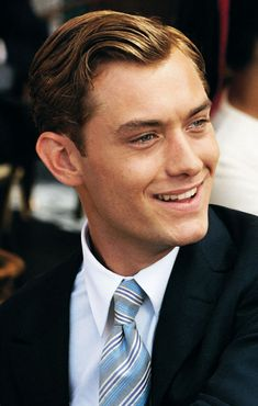 CHARLES BARTOS: pianist, composer, and professor of music. Amy's former boyfriend. (Photo of actor Jude Law).