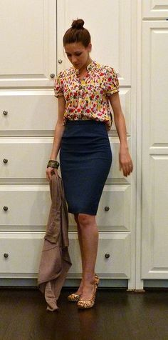 floral blouse and navy pencil skirt.