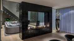 cool black two sided fireplace