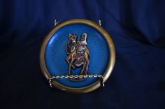 Vintage Teal & Brass Wall Plaque with Man Riding Camel by SoulsationsVintage on Etsy