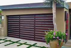 Tungsten Royce manufactures a wide variety of wood garage doors, beautiful driveway gates, real carriage doors, and exterior barn doors to fit your home. Metal Garage Doors, Garage Doors Prices, Custom Garage Doors, Modern Garage Doors, Garage Door Styles, Glass Garage Door, Garage Door Design, Aluminum Garage, Steel Garage