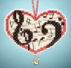 Mill Hill Love Notes - Beaded Cross Stitch Kit. Kit Includes: Beads, charms, perforated paper, needles, floss, chart, and instructions. Can be used as an orname