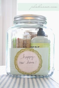 Housewarming gift in a jar via www.julieblanner.com includes dish soap, chip clips, dish towels,
