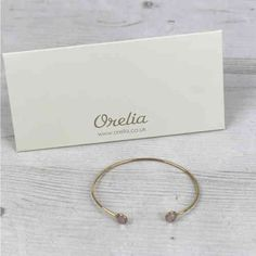 Orelia Gold Coloured Pink Two Stone Bangle Available At Pink Cadillac Boutique www.pinkcadillac.co.uk