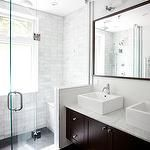 Designer Friend - bathrooms - espresso, double, bathroom cabinet, vanity, marble, countertop, espresso, framed, mirror, white, porcelain, overmount, sinks, double sinks, frameless glass shower, marble, subway tiles, shower surround and double sconces.,