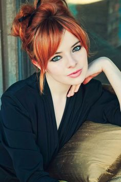 Loooove her bangs. And hair colour.... And updo. Love it all.