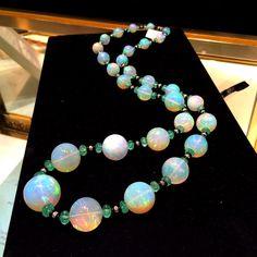 A stunning opal, emerald and onyx David Webb necklace at John Haynes #opals…
