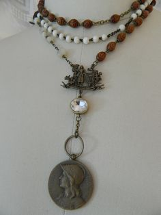 handmade vintage repurposed assemblage jewelry necklace rosary mother of pearl handcarved, joan of arc, french medal atelier paris on etsy by atelierparis on Etsy https://www.etsy.com/listing/163514030/handmade-vintage-repurposed-assemblage