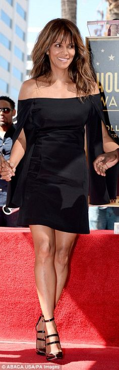 Two paws up: The Catwoman actress looked stunning in this mini dress fromKaufmanFranco...