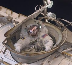 Astronaut Andrew Feustel re-enters the space station after completing an eight-hour spacewalk on 22 May Photograph: ISS/NASA