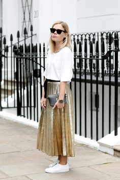 Gold pleated skirt + slouchy white t-shirt + white slip-on shoes