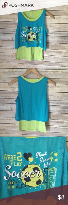 Danskin Now Activewear Tank Top Danskin Now Activewear Tank Top. Good Preowned Condition. There Are No Holes But There Is a Ink Stain In The Back of The Top, It Is Shown In The Last Photo. Smoke and Pet Free Home. No Trades But Reasonable Offers Welcome. Bundle And Save! Danskin Now Shirts & Tops Tank Tops