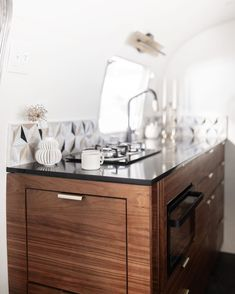 """Mountain Modern Airstream on Instagram: """"There are too many lovely details about Rita's kitchen. The eternal noir black quartz countertops, that gorgeous marble mosaic tile, the…"""" Vintage Trailer Supply, Teak Shower Mat, Marble Tile Backsplash, Marble Mosaic, Black Quartz Countertops, Airstream Restoration, Airstream Living, Custom Pantry, Walnut Cabinets"""