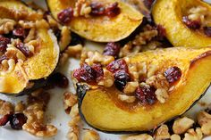 Roasted Acorn Squash with Walnuts and Cranberries Recipe~  This is seriously amazing and perfect for fall!  I just had this at Whole Foods yesterday and I knew I had to come home and find a recipe for it!