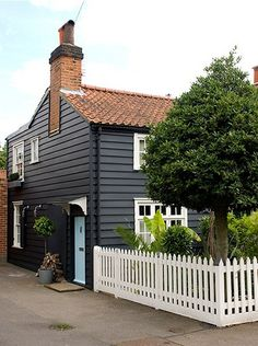 English cottage Inspace by The Estate of Things, via Flickr. Great contrast between the grey clapboard and the coppery roof and bricks.