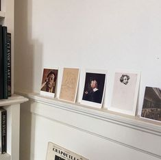 vintage art prints on picture ledge. / sfgirlbybay