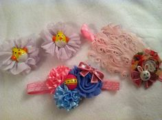 Easter hair bow set, feather pad, chickie pig-tail hair clips and elastic headband on Etsy, $18.00