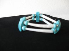 Native American style dentalium shell bracelet with turquoise beads.