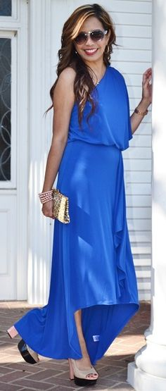 Rebecca looks like a Grecian Goddess in this royal blue hi-lo maxi dress with that sexy bit of leg peeking out.