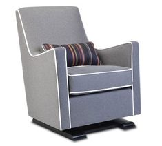 The luca glider chair in heather grey with white piping and Paul Smith grey lumbar pillow - modern nursery furniture by Monte Design. A stylish, eco-friendly and non-toxic glider for your nursery. #FireRetardantFreeGlider #HealthyGlider
