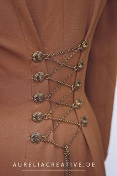 Creative lacing in the back of the Steampunk cloak by Aurelia Creative. Steampunk Jacket, Mode Steampunk, Steampunk Clothing, Steampunk Fashion, Fashion Details, Diy Fashion, Fashion Design, Diy Clothing, Sewing Clothes