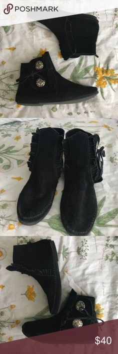 🌚Black Minnetonka Hard Sole Ankle Booties 🌚 Soft black suede leather with two silver buttons on the side. The buttons have a beautiful tribal design and make a jingling noise when you walk (my most favorite part of wearing these shoes). They lace up from the outside and have cool fringe on the front. No major flaws whatsoever. Minnetonka Shoes Moccasins