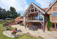 An extended roof detail houses a large balcony with veranda below for entertaining and socialising. Rustic Home Design, Dream Home Design, House Design, House With Balcony, Roof Balcony, Barn House Conversion, Timber Frame Homes, Timber Frames, Oak Framed Buildings