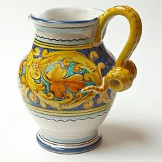 The Palermo pitcher makes an elegant statement piece, with a strong yellow/gold braiding that's crisp and refined - great for showing off fresh flowers or serving iced tea. We call this the curly-cue design because of the intricately crafted handle.  Curly-Cue Palermo Pitcher : Emilia Ceramics #holidayentertaining
