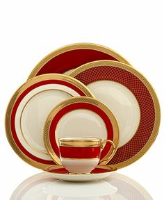 The Embassy Collection by Lenox. Fine China - From Macy's. I really really like this. Wide gold banded rim, wide red splash of color. Each plate's pattern is different...great for mixing with other patterns. Very snazzy!