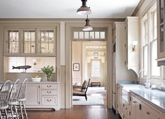 Interior Transoms, Kitchen to next room pass-through with double-sided glass uppers #kitchen