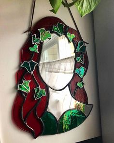 This Poison Ivy-inspired silhouette mirror measures approximately in size and is handmade from deep red and iridescent green glass. Stained Glass Projects, Stained Glass Patterns, Stained Glass Art, Mosaic Glass, Casa Retro, Bedroom Decor, Wall Decor, Arts And Crafts, Diy Crafts