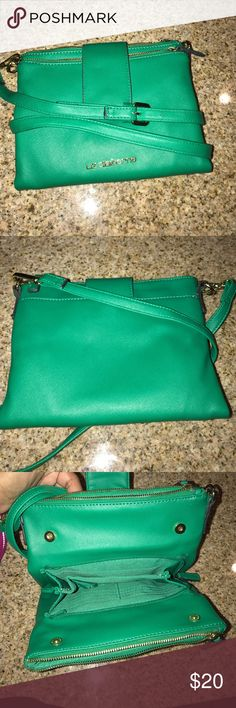 Green cross body purse It was worn once but is in great condition and looks almost brand new! When you open it up it has another middle section to put your credit and debit cards. It is a great cross body! If you have any questions don't hesitate to ask. Liz Claiborne Bags Crossbody Bags