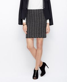 """Above the fray: fringe detail adds an unexpected play of textures to this covetable tweed skirt. Add a pair of high heeled shooties to make your legs look miles long. Hidden side zipper with hook-and-eye closure. Lined. 18 1/2"""" long."""