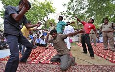 Inmates of Tihar jail, the largest complex of prisons in south Asia, dance as they enjoy a show of music and dance during a musical evening for its inmates in New Delhi, India, Thursday, April 26, 2012. (AP Photo/Saurabh Das)