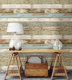 The distressed wood pattern gives the look of reclaimed materials while the cool toned color palette adds a modern touch. Comes on a 20.5 in x 18 ft roll.#windowfilmworld #windowfilm #walldecor #stickwallpaper #homedecor #homedesign