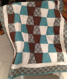 Handmade brown and teal tumbler design patchwork quilt--Use Accuquilt Go! tumbler die.