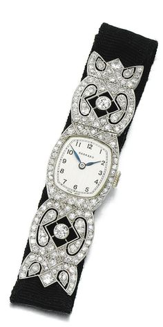 DIAMOND WRISTWATCH, GARRARD, 1920S The cushion-shaped dial applied with Arabic numerals and blued steel hands, to a bezel and hinged extended links of lattice design, millegrain-set with circular- and single-cut diamonds, on an adjustable grosgrain strap, inner circumference approximately 160mm, dial signed Garrard, case numbered, French assay and maker's marks.