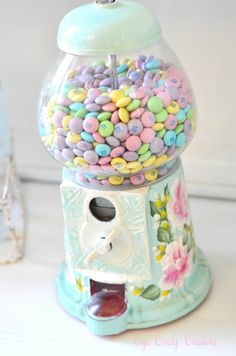 I would love to have this! My grandpa used to have a gumball machine when we were little and we were obsessed with it!