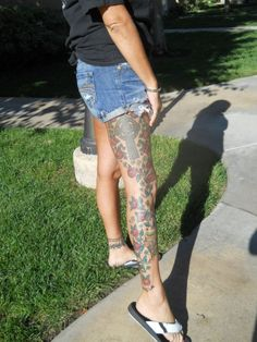 My entire right leg is tattooed with a large celtic cross, red roses, shamrocks, a Irish harp with Gra across it, the Celtic symbol for family on the back, the words: honor without fear (in Gaelic), an eagle (symbol of honor & strength), a Celtic heart, and a single red rosé intertwined in a Celtic knot.