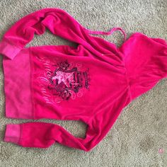 JuiCy CoutuRe vibrant PiNk hoody and pants Top is brand new with plastic tag still attached bottoms are worn but have no stains and the bottoms are in great condition I didn't walk on them I am short and they are long! This outfit fits to your shape and is so comfortable it's very soft and the hoody me back has a beautiful juicy design across it!! Perfect to travel in I love traveling so I get a lot of things great for that!! Stretchy material can fit a small too! Juicy Couture Tops…