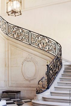 Entrance Foyer with iron railing and marble staircase.